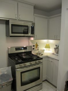 """Add shaker style boards to cupboards, use """"Winter Fog"""" from Rustoleum Cabinet Transformations Light Kit"""
