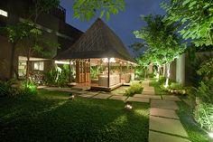 Bali hut sitting in pond