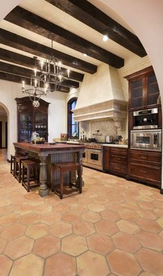 spanish style kitchens | iron lantern pendants are perfect for a