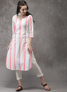 White Striped Kurta is part of Kurta designs women - This modern kurta from Anouk will take your personal style to new heights For your next dinner party or family gathering, this white piece pairs well with dark leggings and chic flats Simple Kurti Designs, Kurta Designs Women, Salwar Designs, Latest Kurta Designs, Designs For Dresses, Dress Neck Designs, Stylish Dresses, Women's Fashion Dresses, Simple Dresses