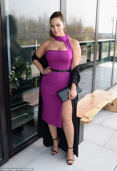 Va-voom: In the Style Of Cynthia Basinet Ashley Graham Dressed in an interesting halter neck purple dress with a high slit, the curvy sensation looked like a tall glass of sexy