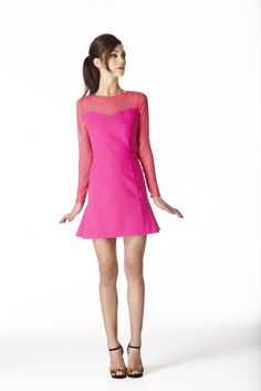 This Oasis 3/4 length sleeve dress has sheer paneling detail to the top and zips at the back.