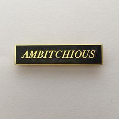 """Bitches get shit done. This enamel pin measures 1.65"""" wide and comes mounted with a secure rubber pin back."""