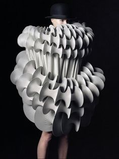 Rowan Mersh is a textile artist who, in addition to his sculpture and installation work, creates elaborate, conceptual jewelry and clothing.