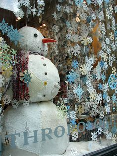 Anthropologie Paper Snowflakes Window Display. Do I wanna do this this year? Hmm