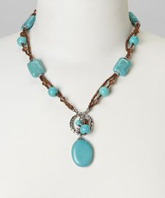Decorate the décolletage with this stunning statement maker. Boasting a chunky silhouette with tantalizing turquoise beads, this chic necklace is perfect for adding a pop of panache to any ensemble. Chain: 17'' long with 3'' extenderPendant: 2.3'' longGlassImported