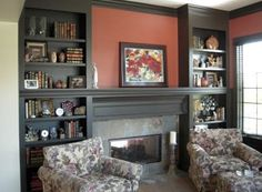 bookcases built around fireplace | These dark built-in shelves around this…