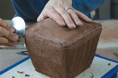 Andrew Avakian makes templates to help generate new slab pottery forms.