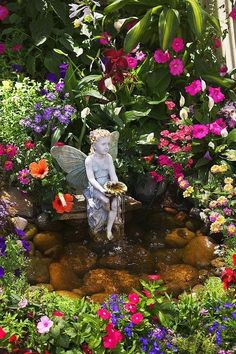 This flower garden looks like a sacred place.The little Winged Fairy Fountain & pond add so much to the beautiful garden.