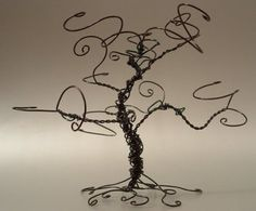 Custom Wire Sculpture    These graceful trees can be used as an earring hanger, or simply as a decoration.