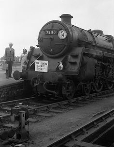 1963-10-06.  British Railways Standard Class 5 4-6-0 73110 THE RED KNIGHT at Westbury on Sunday, 6th October, 1963.    It had taken over the Home Counties Railway Society's 'Mendip Railtour' from a pair of Great Western 'Large Prairie' 2-6-2Ts and would work the train to London Waterloo via Salisbury.    Copyright  ©  Ron Fisher.
