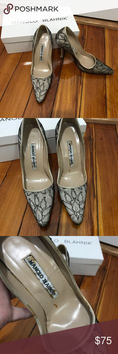 Manolo Blahnik lace black ivory pumps 35 5 Beautiful lace pumps by Manolo Blahnik in size 35. These are true to size 5. They are in pre-owned condition and have some marks on the ivory satin and some wear on the lace as well as some marks on the inner sole. They a have a protective sole added to the ball of the foot. Please see all pictures for details. Manolo Blahnik Shoes Heels