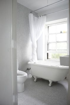 Clawfoot shower curtain that doesn't look cheap! Gray grout on white penny tile going up wall.
