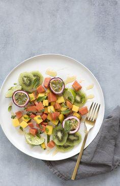 Tropical fruit salad with mango, papaya, kiwi and passionfruit