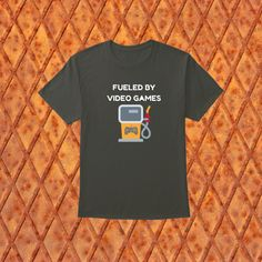 This design will add some fun to your wardrobe or it might make the perfect gift! Gaming Apparel, Video Games, How To Make, Mens Tops, Gift, Fun, Design, Fashion, Moda
