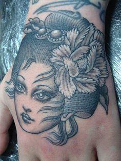 geisha style pin up tattoo.. I love the elaborate hair pieces.