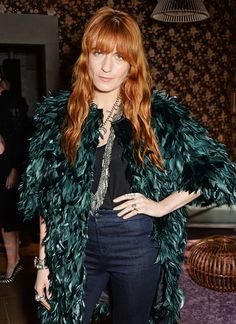 Those deep green feathers offset her fiery locks like nothing else.