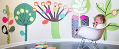 Huge colorful wall decals. Pop & Lolli Chic over-sized fabric wall decals, rich in detail will transform any blank wall into a world of imagination and play.   These wall murals create a complete immersible environment and provide an opportunity for expression & exploration; something every kid deserves.