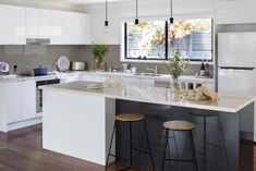 simple, practical kitchen with island bench by kaboodle kitchens