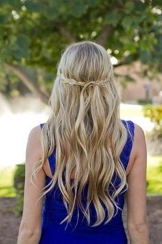 Keep things simple with long beach waves and a small braid from each side of your head coming together in the back to create the real look.