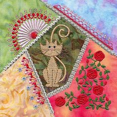 Fantastic crazy quilt with machine embroidery. Love the roses pattern!