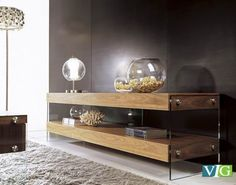 "- Natural Walnut Finish - 2 Shelves - Glass Legs Dimensions: Tv Stand: W73"" x D18"" x H20"" Shelf Thickness: 4"" From Ground to First Shelf: 4"" 8"" Between Shelves CTN/PCS: 2"