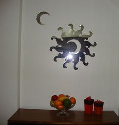 Espelho auto-adesivo  http://www.mysticker.com.br/espelhos_em_acrilico_orientais/lua-sobre-sol-espelhado