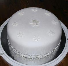 Simple white snowflake cake.