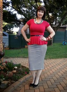 Houndstooth skirt topped off with a red peplum and statement necklace.