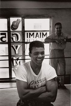 Muhammad Ali, notice the tshirt with his real name at the time, Casius Clay.