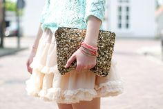 Sequin clutch worn with a ruffle skirt...girly.