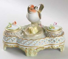 A little bird is centered on this vintage Victorian double ink well...