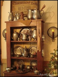 .well how perfect... greens, old hanging cupboard, and pewter!
