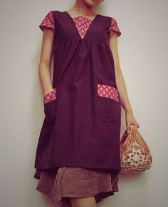 Apron dress. So cute with buttons down the back.