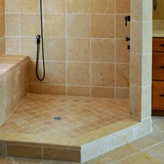 Sand colored tile - small floor tiles, larger wall tiles, small accent bands in the flooor