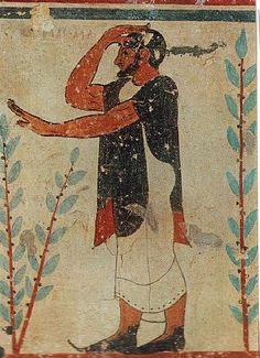 "Detail Etruscan tomb fresco, man wearing the ""Etruscan shoes""."