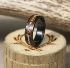 Black men's wedding ring with hammered finish and wood and antler inlays.