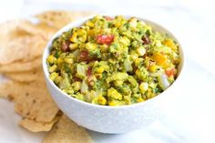 Easy guacamole recipe starring grilled avocados corn and jalapeño is a must make especially if you love guacamole as much as we do. Guacamole Recipe Easy, Homemade Guacamole, Corn Recipes, Pasta Recipes, Healthy Recipes, Free Recipes, Healthy Food, Yummy Food, Quick Recipe Videos