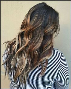 Dark brown hair with honey and light brown highlights