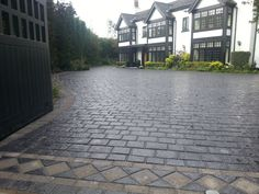 drivesys split stone driveway border detail across the width of the gates