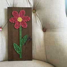 This adorable flower board adds the perfect amount of spring cheer to any space! This listing is for a made to order string art flower sign