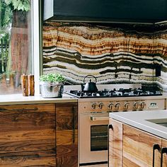 Go onyx! Marble isn't the only natural stone you can use in the kitchen.   This onyx backsplash is a piece of art—no embellishment needed.
