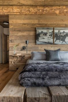 luxury lodge bedroom. grey bedding and faux fur. equestrian wall decor