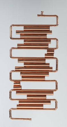 radiator, designed by Laura Sonzogni and made from copper tube. Decorative Radiators, Almirah Designs, Copper Interior, Rose Gold Decor, Copper Decor, Restroom Design, Steampunk House, Copper Tubing, Towel Rail