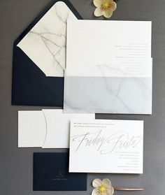 This invitation suite by was foil-printed in gunmetal gray and letterpressed with clear varnish before getting tucked into a marble-printed vellum pocket and then a navy envelope with marble-printed liner. Grey Wedding Invitations, Gold Invitations, Wedding Stationary, Wedding Favors, Invitation Suite, Wedding Ideas, Invitation Ideas, Trendy Wedding, Invitation Design