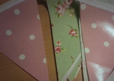 Waterproof shabby chic bunting in sage rosebud and rose spot pvc fabrics.  Bella and the Moo.