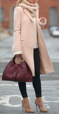 Chocolate long cots and shoes, red bag, black skinny and white sweater street style