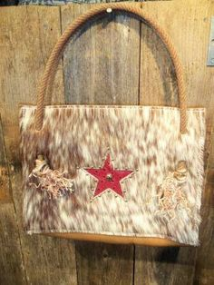 Cowhide purse with star