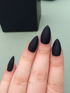 A set of 20 hand painted matte black stiletto fake nails. They come in 10 different sizes (2 of each size included in the set). The size of each nail