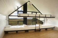 Unusual sleeping arrangements at La Cornette (by yh2 Architecture) in Québec, Canada